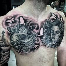 sugar skull guys chest tattoos with day of the dead theme negative