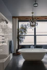 Concrete Floor Bathroom - master bathroom with chandelier by ross j melby zillow digs