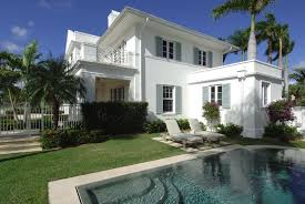 stucco home style white stucco house rooftop deck and bungalow