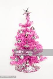 pink christmas tree on white background stock photo getty images
