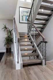 Modern Staircase Ideas Grey Hardwood Floors With Open Staircase U0026 Steel Railings Our