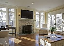 television over fireplace tips for hanging a flat screen tv over a fireplace apartment therapy