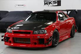 nissan r34 black harlow jap autos uk stock attkd nissan skyline r34 gtr