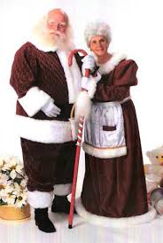 mrs claus costumes santa claus with mrs clause in traditional velvet costumes