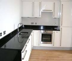White Kitchens With Granite Countertops Black Galaxy Granite White Cabinets Roselawnlutheran