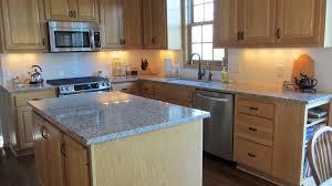 decorating mocca kitchen cabinet with santa cecilia granite