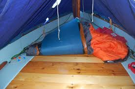 well fitted sleeping platform under the tent on a drascombe lugger
