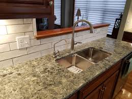 what backsplash looks with cherry cabinets kitchen with cherry cabinets green accents allrounder