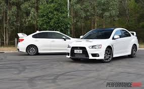 white mitsubishi lancer 2017 2016 mitsubishi lancer evolution vs subaru wrx sti comparison