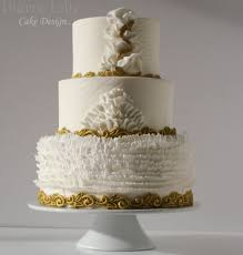 white and gold ruffled wedding cake cake by pierre jolie cake