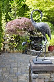 Rocking Bird Garden Ornament by Backyard Patio Stone Stock Photos U0026 Pictures Royalty Free