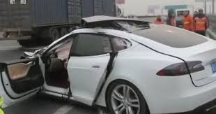 watch the horrifying moment a tesla car crashes into a parked