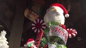 Santa Claus Christmas Tree Decorating Ideas by Santa Claus Climbing Ladder On Christmas Tree Animated Holiday