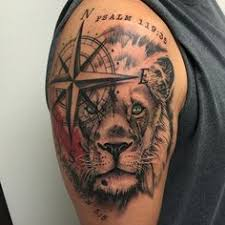 lion and cross tattoo by tj yelp tattoos pinterest lions
