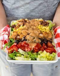 crunchy honey bbq chicken salad garnish with lemon