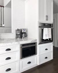 white kitchen cabinets with black drawer pulls finally our kitchen remodel my style diaries