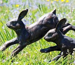 running rabbits metal garden ornament gardensite co uk
