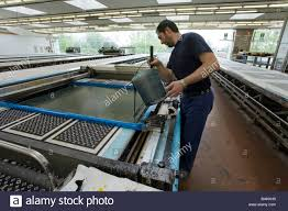 factory in italy the printing tables at the ratti silk factory como italy stock