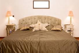 big bed pillows bedroom in which there is a big bed with a coverlet of olive colour