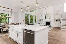 white kitchen cabinets wood floors beautiful white kitchen and living room in new luxury home with