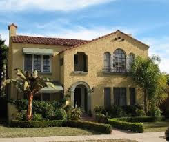 spanish revival homes spanish style exterior paint paint and sage green awnings on the
