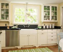 light yellow kitchen with white cabinets kitchen with black appliances yellow kitchen walls with