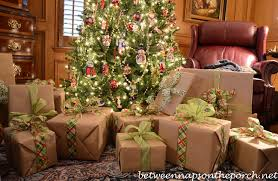 wrapping gifts with plaid ribbons and turning on christmas trees