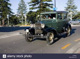 classic vintage 1930 ford green saloon motor car on road art deco
