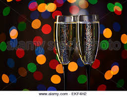 champagne glasses with blurred christmas lights on the background