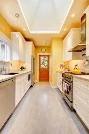 light yellow kitchen with white cabinets yellow kitchen with white cabinets and stove stock image