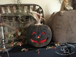 lighted pumpkins for halloween olde pear primitives original goodwill make over lighted pumpkin