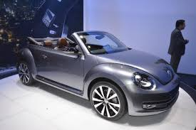 volkswagen beetle purple skydiver jumps into vw beetle convertible from plane for promo
