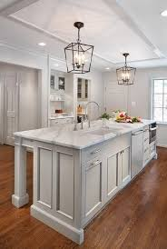 white and gray kitchen features a white ceiling framed with glossy
