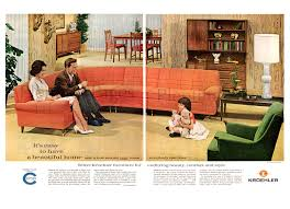 1960s living room with orange couch and green chair living