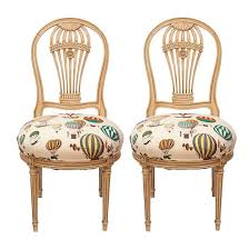 maison jensen balloon chairs upholstered in fornasetti balloon
