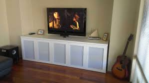 affordable ikea media storage with white painted wooden credenza