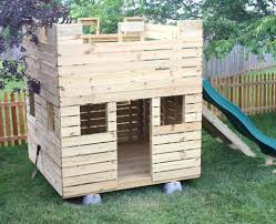 small wooden castle playhouse w slide and gang plank kiddo