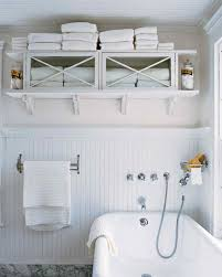 How To Hang Multiple Pictures On Wall by 25 Bathroom Organizers Martha Stewart