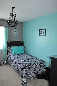i u0027m thinking of aqua walls black furniture and a black white bed