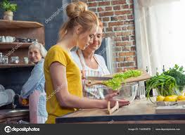 family cooking together in kitchen u2014 stock photo dmitrypoch