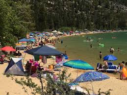 lots of water in lake tahoe means smaller beaches sunbathers