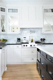 black and white kitchen with marble arabesque tile cooktop