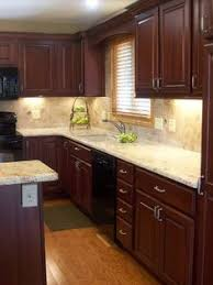 Small Kitchen With Dark Cabinets Kitchen Of The Day This Small Kitchen Features Traditional Rich