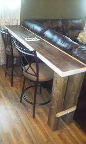 behind couch bar table home furnishings