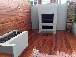 raised beds hardwood trellis bbq fireplace gray colour brick wall