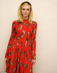 elle fanning steps out in red cat dress as she promotes the neon