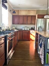 how to add molding to kitchen cabinets building cabinets up to the ceiling from thrifty decor