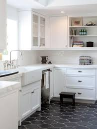 white kitchen cabinets black tile floor kitchen remodeling on a budget 3 kitchen remodel small