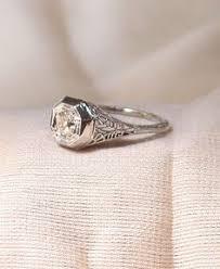 vintage art deco three quarter carat diamond engagement ring in