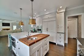 butcher block kitchen island breakfast bar traditional kitchen with hardwood floors inset cabinets in